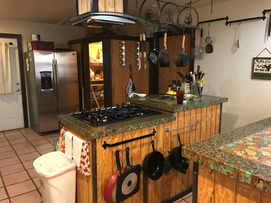 Kitchen with gas stove and real turquoise counter tops.