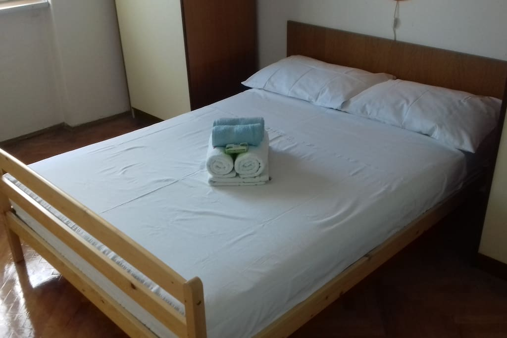Bed equipped for summer from right side
