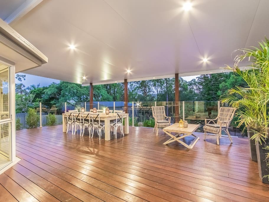 wide open entertaining deck with views to parkland. 10 seater table plus separate setting for eight.