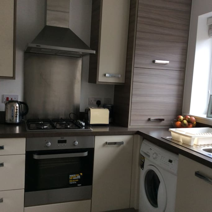 Very compact kitchen fridge freezer microwave washing machine dining table 5 chairs ,kitchen looking out to my lovely garden where you can sit chilling with a nice bottle of wine