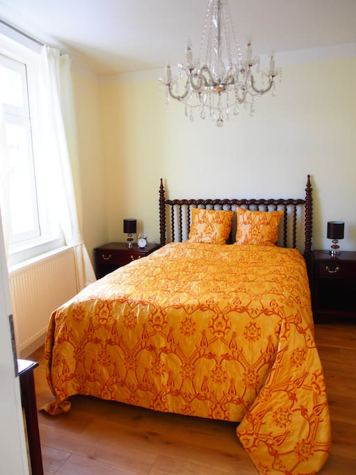 Bedroom with Boxspring bed and feather pillow