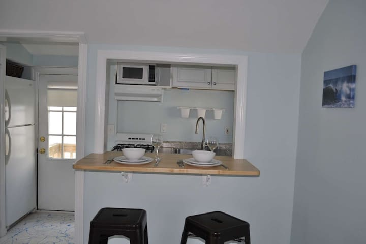 The petite kitchen is fully appointed with a full size fridge to hold plenty of drinks and snacks, dinner for 2 ...