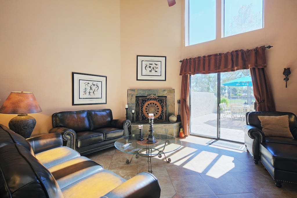 Access to the first floor patio, with views of the golf course, extends the indoor living room outdoors.