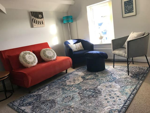 Lounge with new sofa bed and chairs,  new drop leaf dining table, occasional tables, games, books and puzzles. Flat screen tv with Sky package, Bluetooth speaker and hi fi system. Information about appliances, maps, local walks and local attractions.