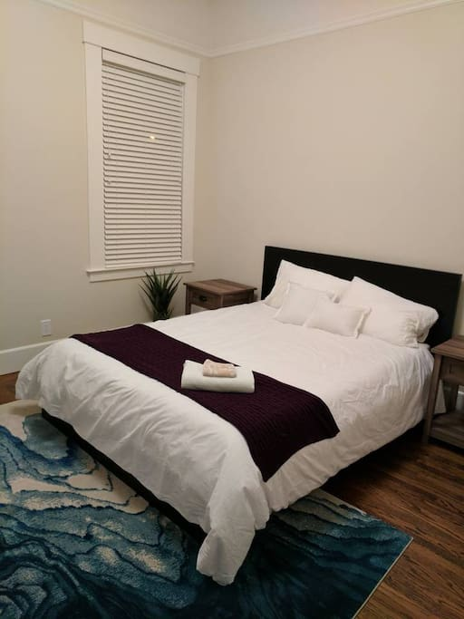 The master bedroom has a queen bed, a comfy chair, a large walk-in closet and an ensuite bathroom.