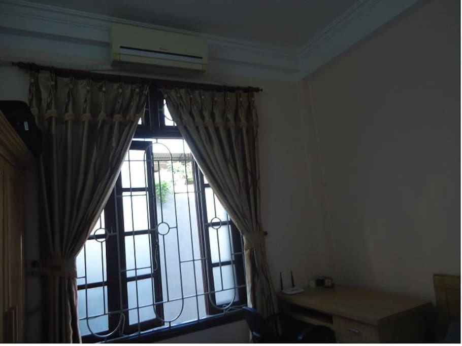 Room 1: The room with air- conditioned , the window overlooking the street very airy,  natural light