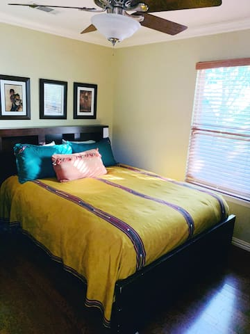 Queen size bed in third bedroom with down pillows and blanket..