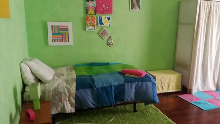 AZULEJOS ROOM bed ,small closet  and balcony