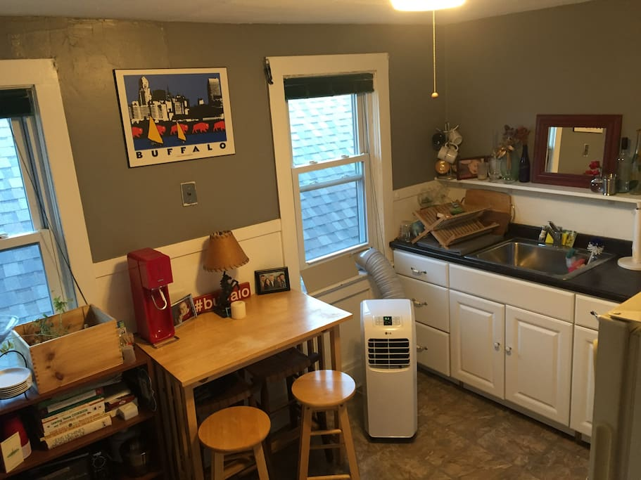 Kitchen complete with a stocked, modest bar, air conditioning and updated appliances.