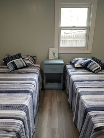 Bedroom #3 features two twin beds, a dresser, and closet. The mattresses will work for the kiddos, but were chosen for comfort with the adults in mind.