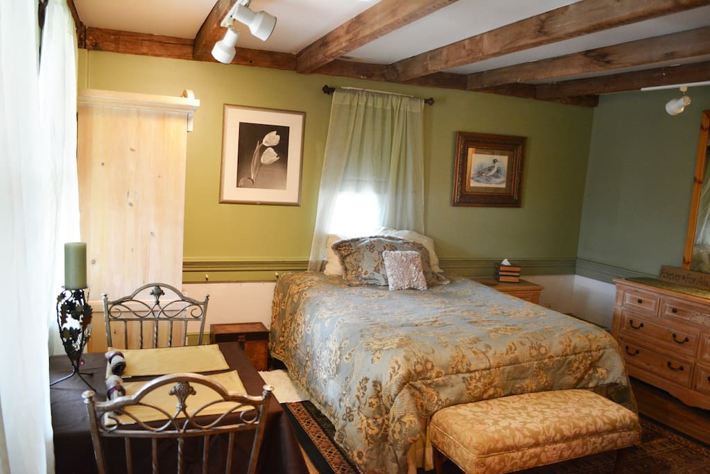 Enjoy the comfort of your Queen-size cushy bed, high ceiling with beams, in a spacious room.