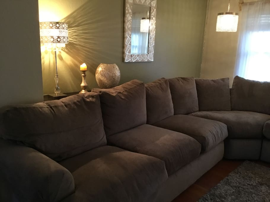 A cozy living room on the main floor with a down feather couch; it's large enough it takes 2 pictures to see it all!