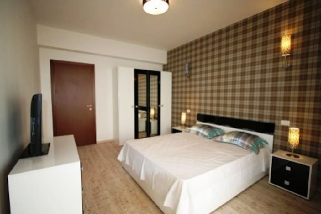 The bedroom is very spacious and is equipped with a king size bed.
