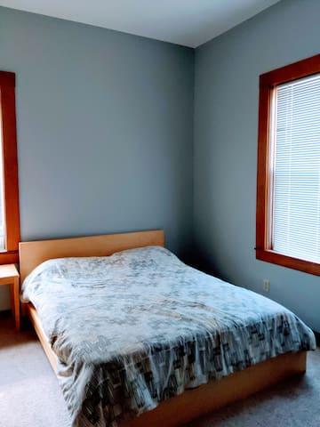 Corner bedroom with giant windows