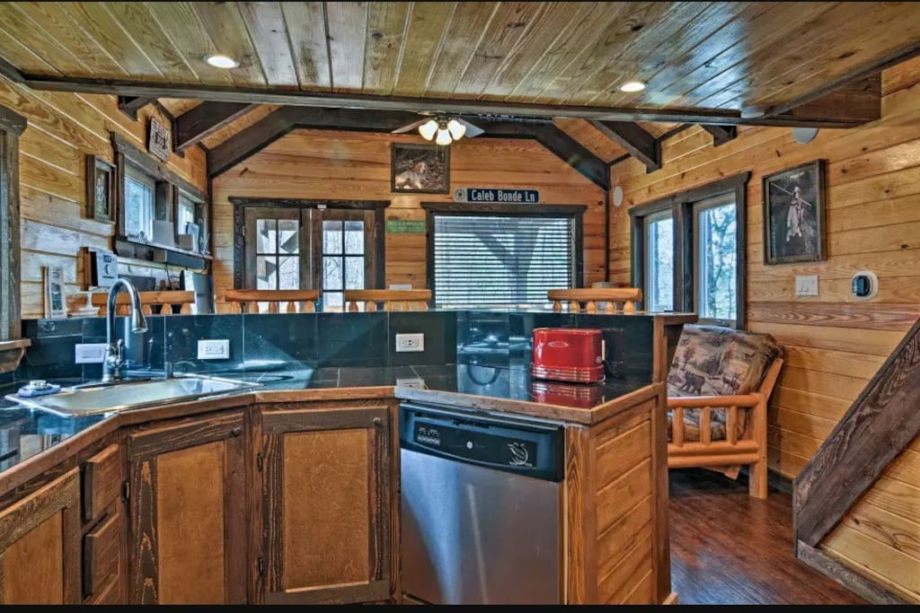This amazing kitchen features high-end GE appliances as well as a retro-themed toaster, toaster oven/broiler, coffee pot and microwave.