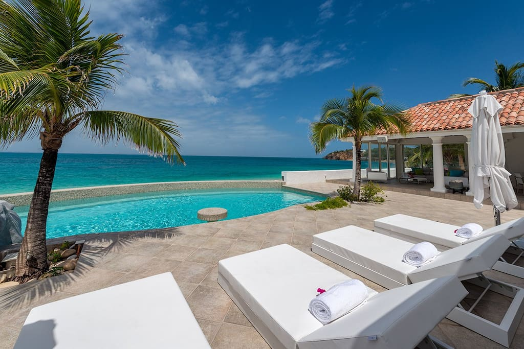 Lounge along the beach, swim in your private pool. Hear the swish of the palms?