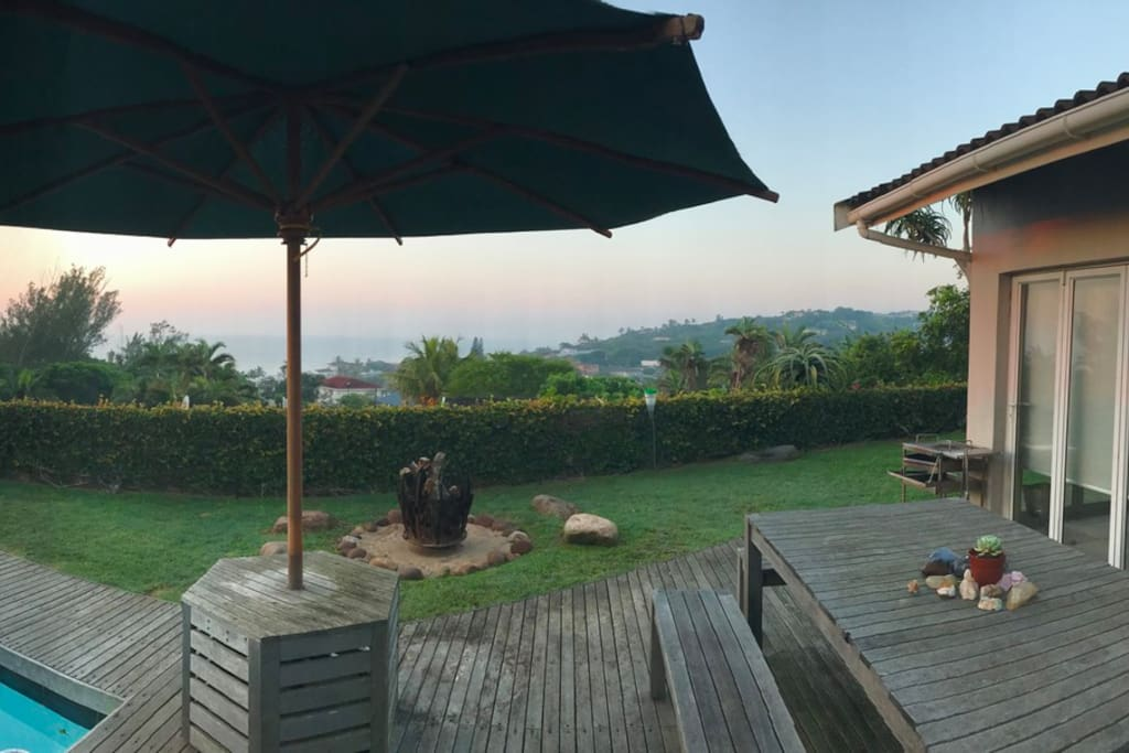 Deck, pool, outside dining, fire pit and braai/ barbecue area
