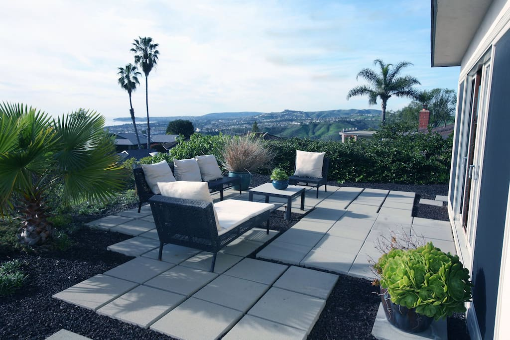 The patio offers an outdoor retreat with comfortable seating and an ocean view.