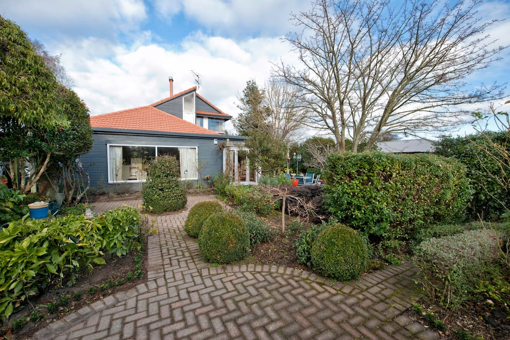Lovely English cottage style gardens surround the property