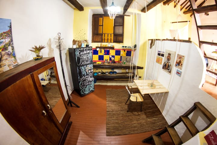 This is an space for people who want to feel the particular, bohemian and characteristic atmosphere of La Candelaria - Open kitchen and dinning room