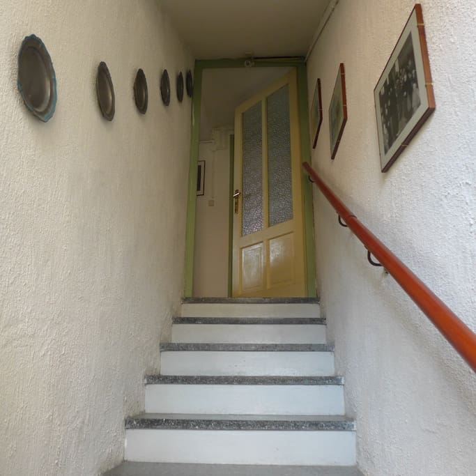 after the entrance door you walk up these stairs to the flat