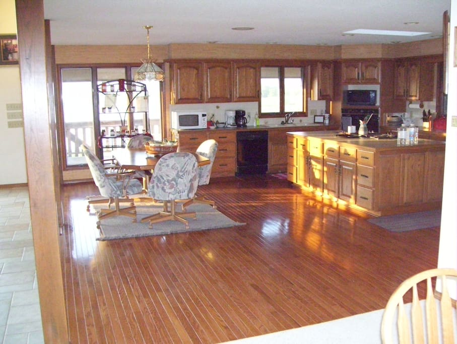 Large Kitchen with Microwaves, Coffee Pots, Dishes, Silverware and Cooking utensils