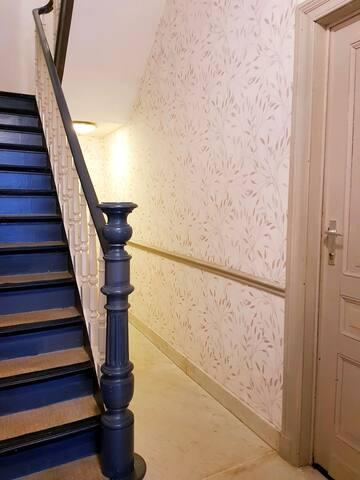 Bedroom's door on the right