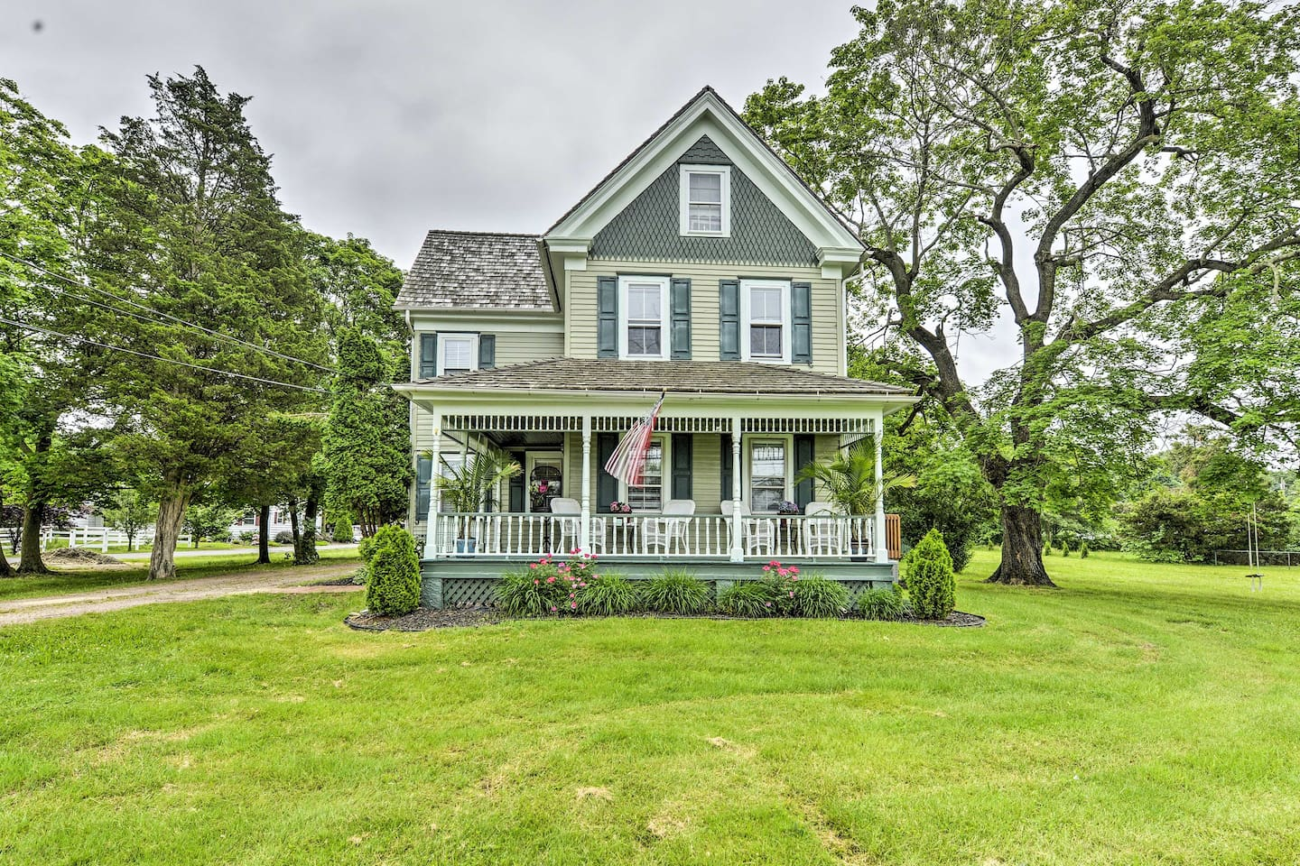 The charming, updated New Jersey home sits on a ranch with horses!