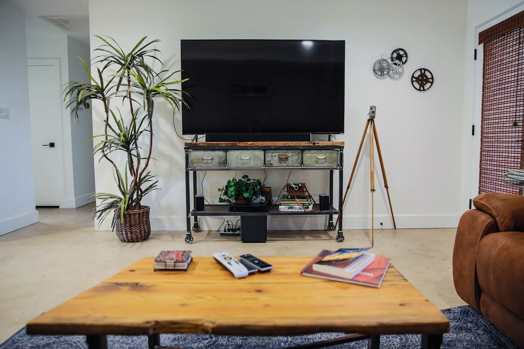 """70"""" high def TV with Playstation with games and DVD's"""