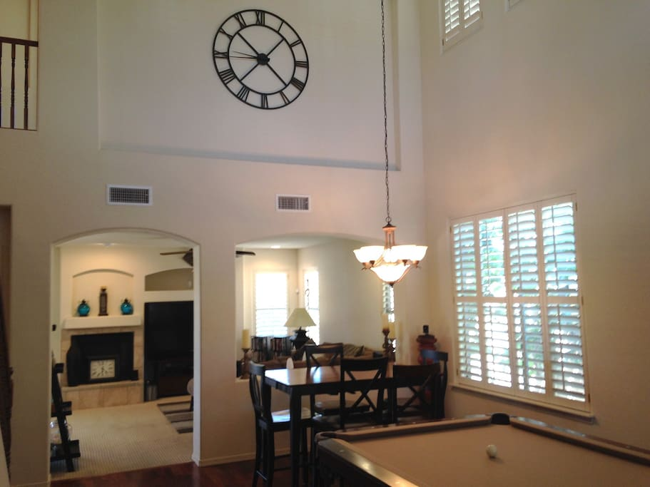 Walk in to the large living room with 2-story ceiling, expandable dining table and professional-quality billiards table.