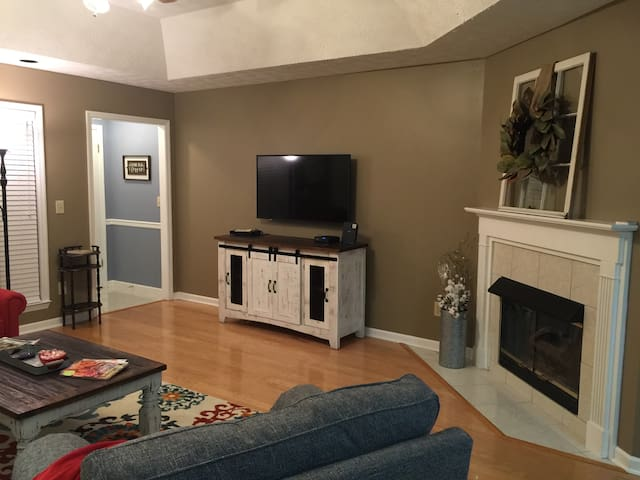 Den with HD Smart TV and gas fireplace