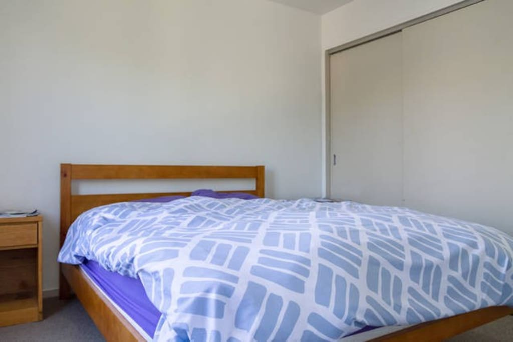 Comfortable and clean queen sized bed that fits two adults. Crisp and clean bedsheets.