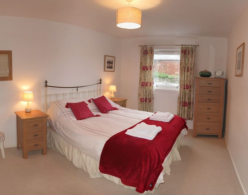 comfortable kingsize bed. Walk in wardrobe and quiet aspect.
