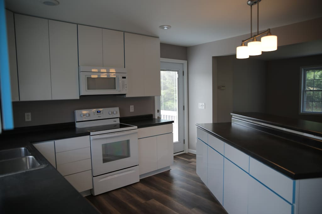 Large open Kitchen with all basics necessary for simple meals. Keurig / coffee maker + coffee onsite.