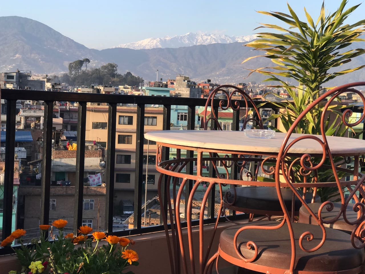 rooftop table with  mountain  & city views