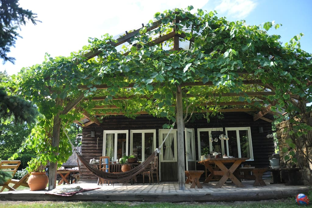 Attached to the main house is a large covered outdoor area, where we have all our meals during summertime