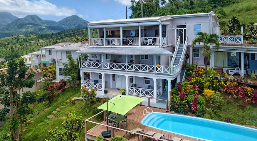 This spacious hotel room with a king size bed and a twin size sofa bed has air-conditioning, refrigerator and more amenities. It is on the middle floor with the pool right at the front.