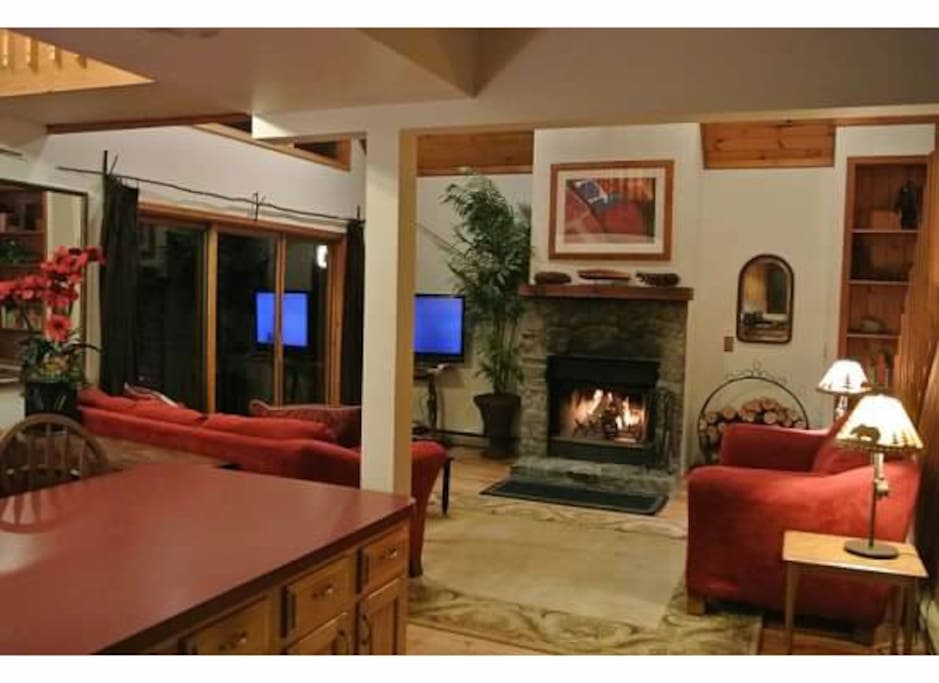 Living Room with fire place and sliding glass doors