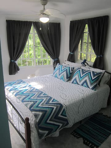 Comfy queen bed with a/c or you can leave screened windows open