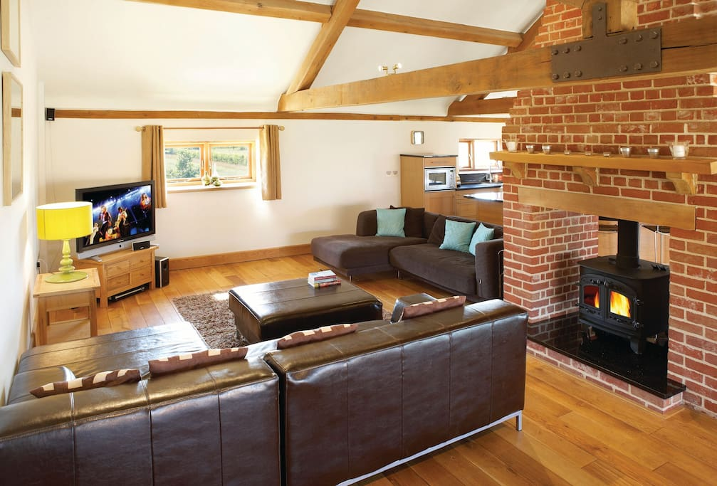 First floor: Open plan kitchen, dining and sitting area with wood burning stove