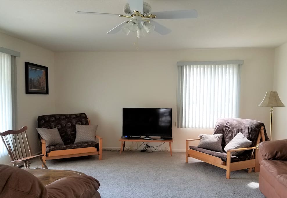 Relax on cozy couches and cable television viewing on the big screen in the living room of our Classic Country Charmer.  Guests also love listening to music through our cable provider.