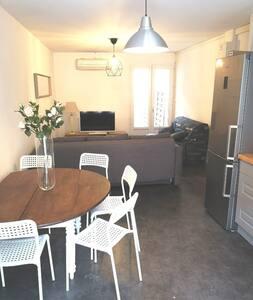Grand appartement T2 climatisé avec patio en RC