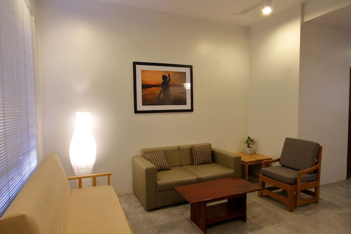 Living room is airy and clean and comfortably seats 5 people. Has cable tv with 96 local and international channels.