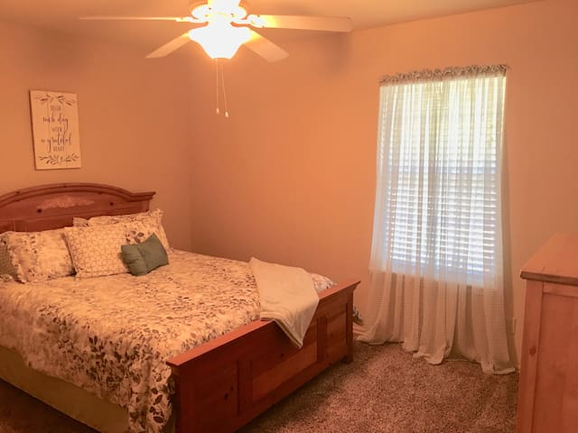 Private bedroom with walk-in closet and dresser.