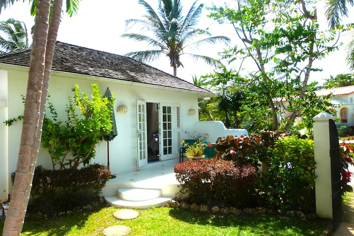 The guest cottage is separate from the main villa, nestled in our front garden