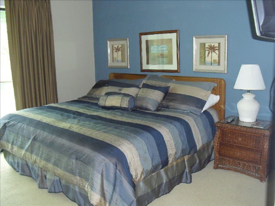 King Bed Master with ensuite and private balcony overlooking the pool.