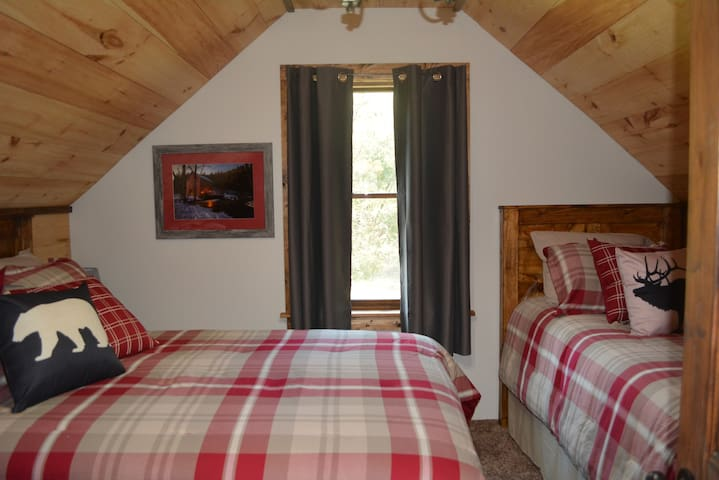 Bedroom 3 on the south end of the second floor includes a full size bed and a twin bed, offering sleeping space for up to 3 people