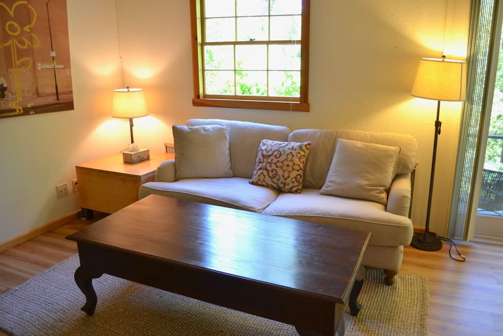 Large, new high-end linen-upholstered couch, solid-wood coffee table