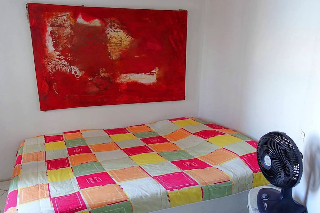 Double room with art work on the wall