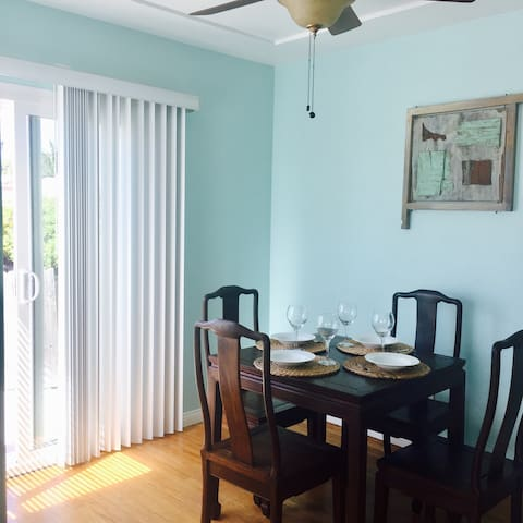 Quaint dining area opening up to your private garden patio...